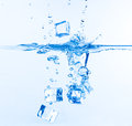 Ice Cubes Dropped Into Water With Splash Stock Photo - 29400340