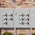 Electricity Meters On  A Brick Wall. Stock Photo - 29405600
