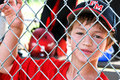 Youth Baseball Player In Dugout Royalty Free Stock Image - 29433036