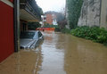 Car In The Courtyard Of The House Submerged By Flood Mud Stock Photos - 29464723