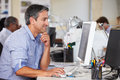 Man Working At Desk In Busy Creative Office Stock Photography - 29482322