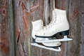 Old Skates Hanging On A Wooden Wall Stock Photo - 29527960