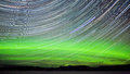 Star Trails And Northern Lights In Night Sky Stock Image - 29534671