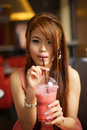 Young Beautiful Woman Sitting In Cafe Holding And Drinking A Fru Stock Photo - 29535930