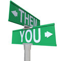 You Versus Vs Them Two Way Road Street Signs Stock Photo - 29539700