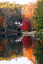 Red Maple And House Reflected Stock Photography - 29576572