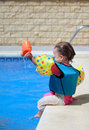 Baby Girl By Swimming Pool Royalty Free Stock Photos - 2965258