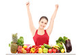 Excited Young Female Gesturing Happiness On A Table Full Of Frui Stock Photos - 29608933