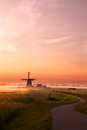 Windmill And Horses On Pasture At Sunrise Royalty Free Stock Photography - 29616097
