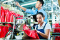 Seamstress And Shift Supervisor In Textile Factory Royalty Free Stock Photo - 29643355