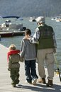 Grandfather Walking With Grandsons On Pier Stock Photos - 29645573