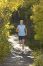 Middle Aged Man Jogging Stock Photography - 29647272