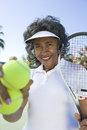 Female Tennis Player Holding Racquet And Balls Stock Images - 29652384