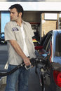 Worker Refueling Car At Station Royalty Free Stock Photo - 29658015