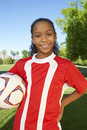 Girl Standing With Soccer Ball Stock Images - 29658244