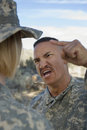 Military Officer Yelling At Female Soldier Royalty Free Stock Photos - 29659858