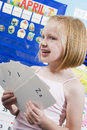 Girl With Alphabet Flash Cards Stock Photo - 29662590