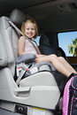 Girl Sitting In Booster Seat Stock Photo - 29662830