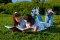 Two Girls Reading Books Outside In A Park Stock Photography - 29663452