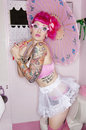 Tattooed Woman In Eyeglasses Holding Parasol Stock Photography - 29668082