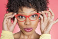 Portrait Of An African American Woman Wearing Retro Style Glasses Over Colored Background Stock Photo - 29673470