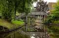 Reflection Of Wooden Bridges On Canals Of Giethoorn Stock Photography - 29675512