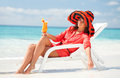Woman Drinking Cocktail On The Beach Royalty Free Stock Image - 29690876
