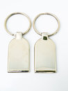 A Pair Of Metalic Trinket Keychain Isolated On White Background Stock Photo - 29693630