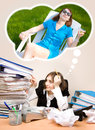Young Secretary With A Lot Of Folders Dreaming Of A Summer Stock Photo - 29703000