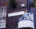 Street Corner Sign And Statue In York Stock Photos - 29706503