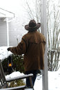 American West Legend Cowboy Contemplating New Snow Stock Image - 29708631