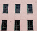 Green Windows In Pink Stucco Royalty Free Stock Images - 29729949