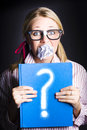 Cautious Woman Holding Book Of Education Questions Royalty Free Stock Image - 29764276
