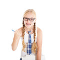 Teenage Girl Wearing A School Uniform And Glasses Holding A Laptop. Girl Showing A Fist. Stock Image - 29769601
