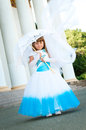 Little Bride. A Girl In A Lush White And Blue Wedding Dress. Royalty Free Stock Images - 29777999