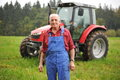 Farmer And His Red Tractor Royalty Free Stock Photo - 29799375
