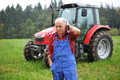 Farmer And His Red Tractor Royalty Free Stock Photo - 29799415