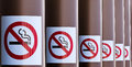 Row Of No Smoking Signs On Series Of Columns Stock Photo - 29807390