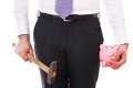 Businessman With Piggy Bank And Hammer. Royalty Free Stock Photos - 29835758