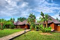 Path To Wooden African Chalets Stock Photos - 29839023