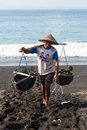 Traditional Sea Salt Production On The Volcanic Black Sand, Bali Royalty Free Stock Photography - 29865507