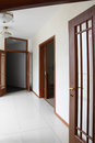 Empty Corridor With Wooden Doors Royalty Free Stock Photography - 29868857