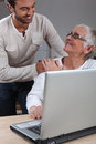 Helping Mother On Laptop Royalty Free Stock Photo - 29880105