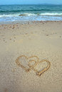 Two Hearts Drawn In Sand Royalty Free Stock Photo - 29887975