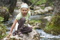 Small Tourist Sitting By A Mountain River Royalty Free Stock Photos - 29889528