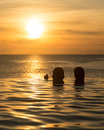 Infinity Edge Pool With Sea Underneath Sunset Stock Photos - 29897693
