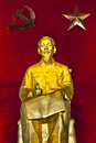 Ho Chi Minh Statue In Red Background With Hammer And Sickle. Royalty Free Stock Images - 29898719