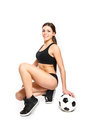 Attractive Young Woman Posing With A Soccer Ball On A White Back Stock Image - 29917551