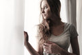 Beautiful Long Hair Blond Girl Looks Out The Window Stock Images - 29928854