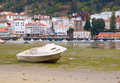A Boat At Low Tide In Pontedeume Royalty Free Stock Photos - 29949518